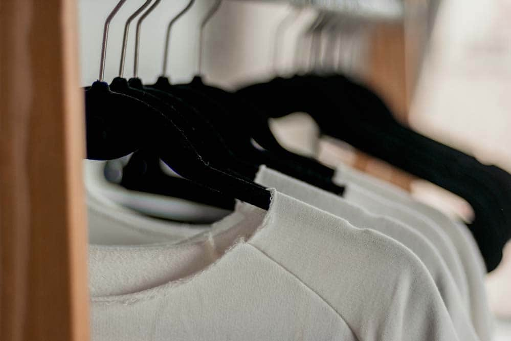 decide what to wear when you start running and go for something simple and cheap ideally an old t shirt and shorts